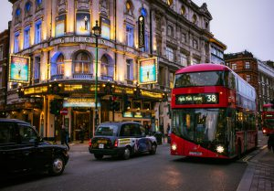 London, UK - November 23, 2015: Pedestrians, buses and taxis passing the Gielgud Theatre on Shaftesbury Avenue in London's West End, an area well known for theatre productions.